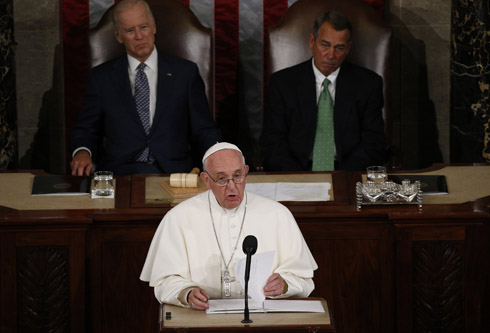Pope Francis addresses a joint meeting of the U.S. Congress as Vice President Joe Biden (left) and Speaker of the House John Boehner look on in the House of Representatives Chamber at the U.S. Capitol in Washington Sept. 24. (CNS photo/Paul Haring) See POPE-CONGRESS Sept. 24, 2015.