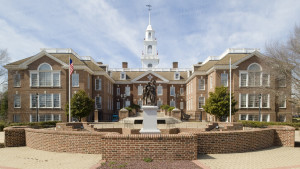 "An image of Delaware Legislative Hall, which serves as the Delaware state capitol, in Dover.  In the foreground is ""The Delaware Continentals,"" sculpted by Ron Tunison and dedicated in 2008.  E. William Martin designed the Georgian Revival structure.  Delaware Legislative Hall opened in 1933.  This image © Capitolshots Photography, ALL RIGHTS RESERVED."